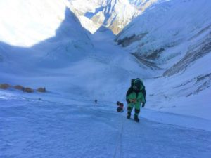 IMG Climber on the Lhotse Face with Camp 2 below (Kevin Kayl)